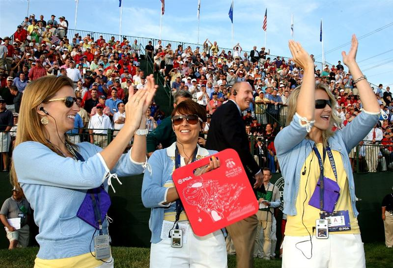 LOUISVILLE, KY - SEPTEMBER 19:  (L-R) Kate Rose, Laurae Westwood and the partner of Oliver Wilson, Laura Smith, cheer on the first hole during the morning foursomes on day one of the 2008 Ryder Cup at Valhalla Golf Club on September 19, 2008 in Louisville, Kentucky.  (Photo by David Cannon/Getty Images)