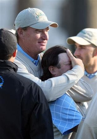 SAN FRANCISCO - OCTOBER 09: Ernie Els of South Africa and the International Team gets hold of Tim Clark of South Africa after Clark had just holed a great eagle putt at the 18th hole to win his match with Vijay Singh against Cink and Glover of the USA Team during the Day Two Fourball Matches in The Presidents Cup at Harding Park Golf Course on October 9, 2009 in San Francisco, California  (Photo by David Cannon/Getty Images)