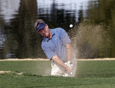 John Cook blasts out of the greenside bunker on the 1st hole during the final round of the 2006 Chrysler Classic of Tucson on Sunday , February 26, 2006 at the Omni Tucson National Golf Resort and Spa in Tucson, ArizonaPhoto by Marc Feldman/WireImage.com