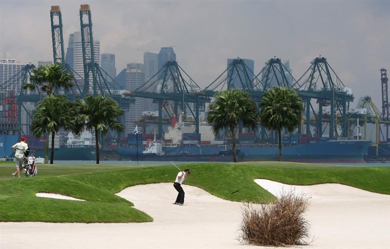 SINGAPORE - NOVEMBER 16:  Padraig Harrington of Ireland hits from a bunker during the final round of the Barclays Singapore Open at Sentosa Golf Club on November 16, 2008 in Singapore.  (Photo by Ian Walton/Getty Images)