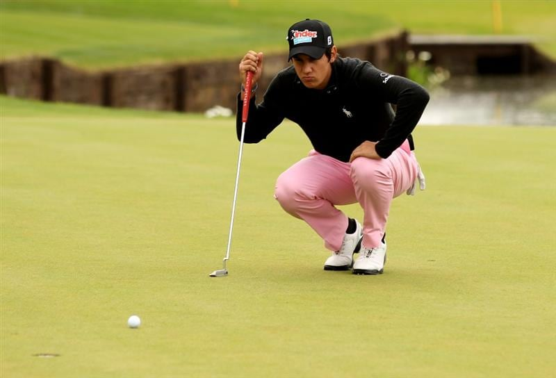 VIRGINIA WATER, ENGLAND - MAY 28:  Matteo Manassero of Italy lines up a putt on the 18th green during the third round of the BMW PGA Championship at the Wentworth Club on May 28, 2011 in Virginia Water, England.  (Photo by Ian Walton/Getty Images)