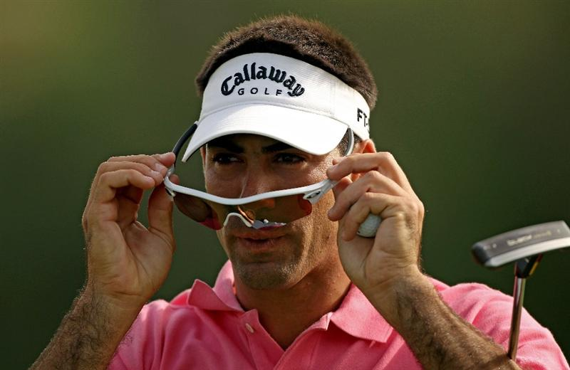 DUBAI, UNITED ARAB EMIRATES - FEBRUARY 07:  Alvaro Quiros of Spain adjusts his sunglasses on the 12th hole during the final round of the Omega Dubai Desert Classic on February 7, 2010 in Dubai, United Arab Emirates.  (Photo by Andrew Redington/Getty Images)