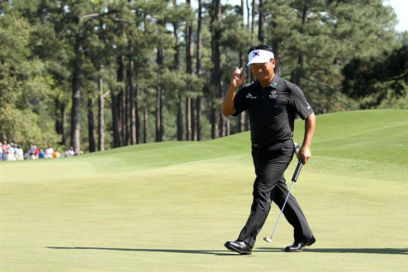 AUGUSTA, GA - APRIL 11:  K.J. Choi of South Korea waves to the gallery on the eighth green during the final round of the 2010 Masters Tournament at Augusta National Golf Club on April 11, 2010 in Augusta, Georgia.  (Photo by Andrew Redington/Getty Images)