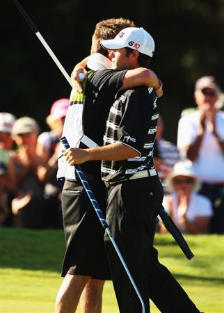 QUEENSTOWN, NEW ZEALAND - MARCH 15:  Alex Prugh of the USA (R) hugs his caddy on the 18th on day four of the New Zealand Men's Open Championship at The Hills Golf Club on March 15, 2009 in Queenstown, New Zealand.  (Photo by Phil Walter/Getty Images)