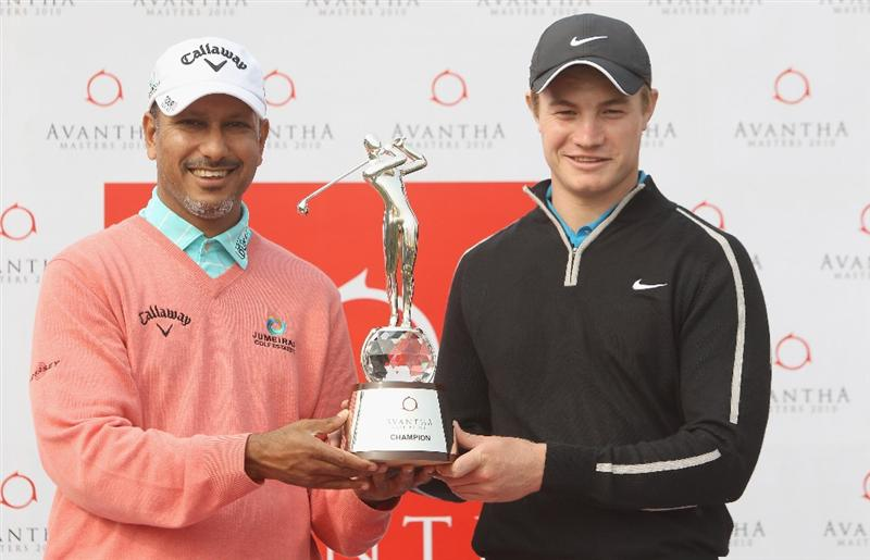 NEW DELHI, INDIA - FEBRUARY 10:  Oliver Fisher of England and Jeev Milkha Singh of India pose for photographer at the Trophy unveiling during the Pro-AM of the Avantha Masters held at The DLF Golf and Country Club on February 10, 2010 in New Delhi, India.  (Photo by Ian Walton/Getty Images)