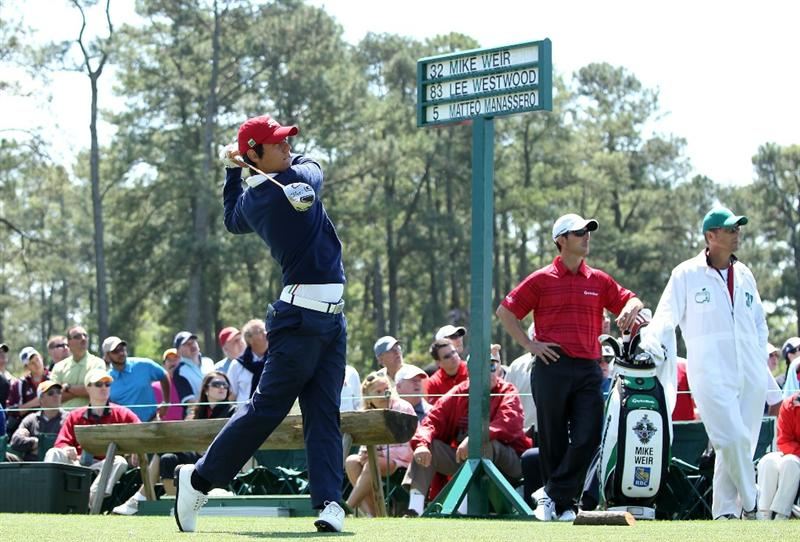 AUGUSTA, GA - APRIL 09:  Amateur Matteo Manassero of Italy hits his tee shot on the first hole as Mike Weir of Canada looks on during the second round of the 2010 Masters Tournament at Augusta National Golf Club on April 9, 2010 in Augusta, Georgia.  (Photo by Andrew Redington/Getty Images)