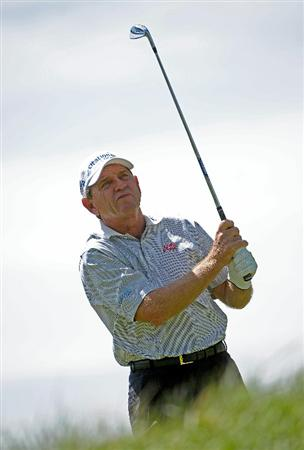 PARKER, CO - MAY 27:   Nick Price of Zimbabwe tees off the par three 2nd hole  during the first round of the Senior PGA Championship at the Colorado Golf Club  on May 27, 2010 in Parker, Colorado.  (Photo by Marc Feldman/Getty Images)