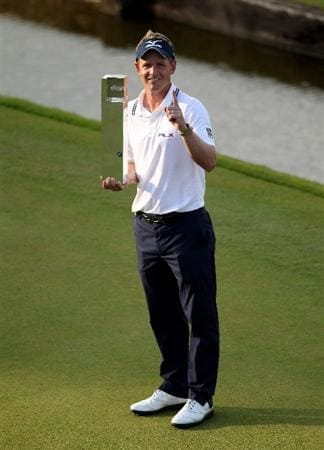 VIRGINIA WATER, ENGLAND - MAY 29:  Luke Donald of England holds the trophy following his victory in a playoff, which also secured him the Number One World Ranking during the final round of the BMW PGA Championship  at the Wentworth Club on May 29, 2011 in Virginia Water, England.  (Photo by Andrew Redington/Getty Images)