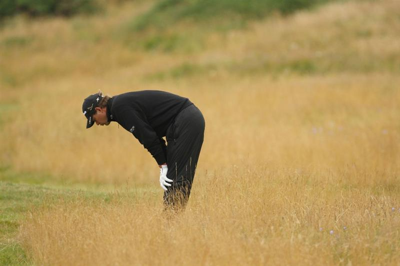 TURNBERRY, SCOTLAND - JULY 17:   Retief Goosen of South Africa checks the lie of his ball during round two of the 138th Open Championship on the Ailsa Course, Turnberry Golf Club on July 17, 2009 in Turnberry, Scotland.  (Photo by Ross Kinnaird/Getty Images)
