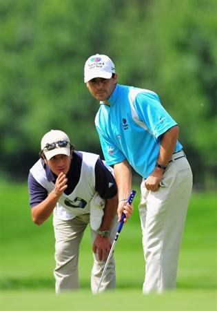 MUNICH, GERMANY - JUNE 27:  Felipe Aguilar of Chile and caddie line up his putt on the 13th hole during the third round of The BMW International Open Golf at The Munich North Eichenried Golf Club on June 27, 2009, in Munich, Germany.  (Photo by Stuart Franklin/Getty Images)