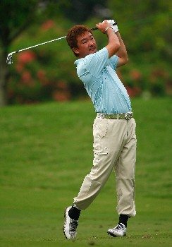 JAKARTA, INDONESIA - FEBRUARY 14:  Mitsuhiro Tateyama of Japan plays his approach shot on the 13th hole during the first round of the 2008 Enjoy Jakarta Astro Indonesian Open at the Cengkareng Golf Club on February 14, 2008 in Jakarta, Indonesia.  (Photo by Stuart Franklin/Getty Images)