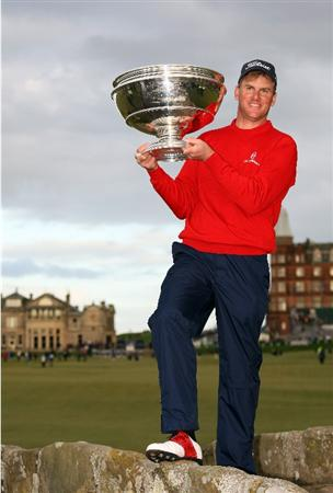 ST. ANDREWS, UNITED KINGDOM - OCTOBER 05: Robert Karlsson of Sweden celebrates with the trophy on the Swilken Bridge on the 18th hole after victory in The Alfred Dunhill Links Championship at The Old Course on October 5, 2008 in St.Andrews, Scotland. Karlsson after defeating Ross Fisher and Martin Kaymer in a play off.  (Photo by Ross Kinnaird/Getty Images)