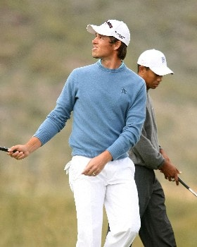 MARANA, AZ - FEBRUARY 22:  Aaron Baddeley (L) of Australia reacts to losing the 15th hole to Tiger Woods during the third round matches of the WGC-Accenture Match Play Championship at The Gallery at Dove Mountain February 22, 2008 in Marana, Arizona.  (Photo by Scott Halleran/Getty Images)