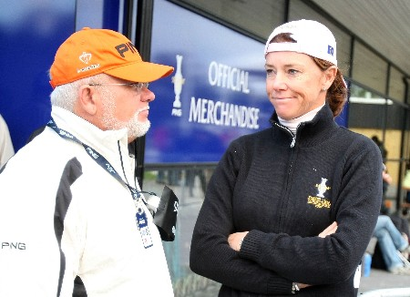 HALMSTAD, SWEDEN - SEPTEMBER 15:  Chairman John Solheim waits with European Team Captain Helen Alfredsson after play was suspended for dangerous weather conditions during the morning foursome matches of the Solheim Cup at on September 15, 2007 in Halmstad, Sweden.  (Photo by Scott Halleran/Getty Images)