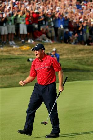 LOUISVILLE, KY - SEPTEMBER 21:  J.B. Holmes of the USA team celebrates his birdie putt on the 17th green to secure a 2 & 1 victory during the singles matches on the final day of the 2008 Ryder Cup at Valhalla Golf Club on September 21, 2008 in Louisville, Kentucky.  (Photo by Andrew Redington/Getty Images)