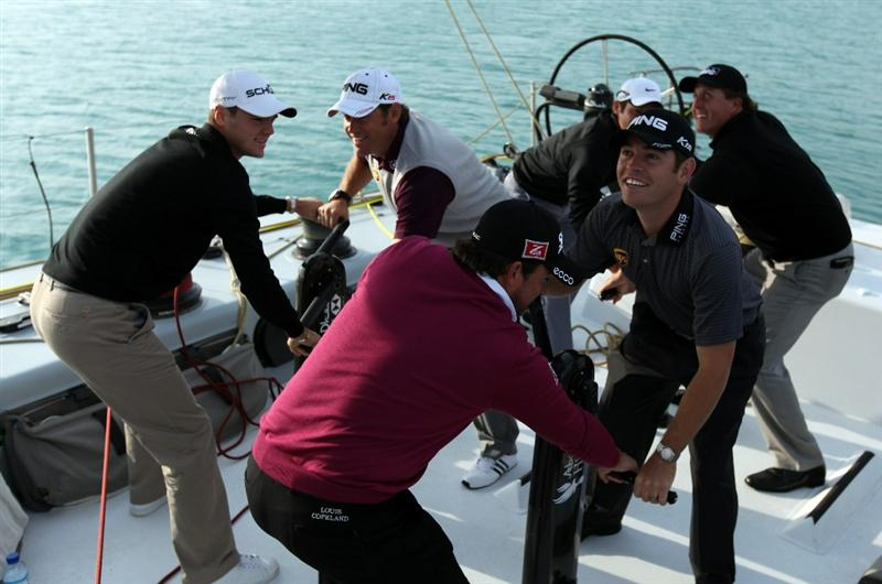 ABU DHABI, UNITED ARAB EMIRATES - JANUARY 18:  Graeme McDowell of Northermn Ireland, Louis Oosthuizen of South Africa, Martin Kaymer of Germany, Lee Westwood of England, Paul Casey of England, and Phil Mickelson of the USA grinding the main sail on board the Abu Dhabi Ocean Racing entry for the 2011 Volvo Ocean Race as a preview for the 2011 Abu Dhabi HSBC Golf Championship to be held at the Abu Dhabi Golf Club on January 18, 2011 in Abu Dhabi, United Arab Emirates.  (Photo by David Cannon/Getty Images)