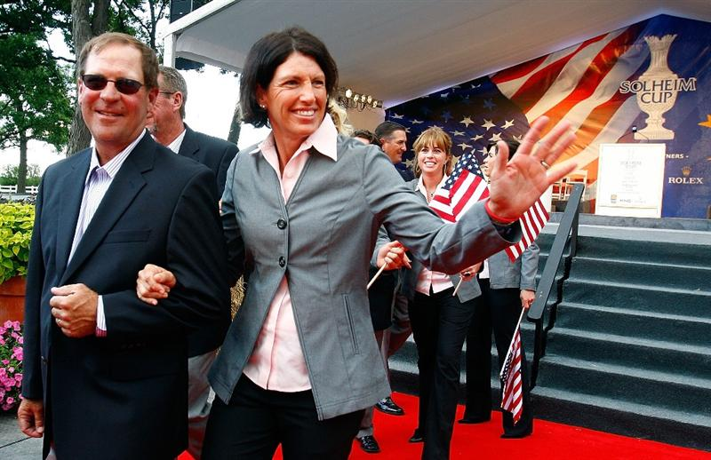 SUGAR GROVE, IL - AUGUST 20:  Juli Inkster of the U.S. Team walks with her caddie Worth Blackwelder during the Opening Ceremonies prior to the start of the 2009 Solheim Cup at Rich Harvest Farms on August 20, 2009 in Sugar Grove, Illinois.  (Photo by Scott Halleran/Getty Images)