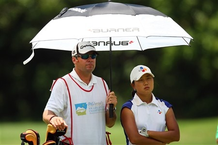 ROGERS, AR - JULY 6:  Seon Hwa Lee of South Korea attempts to keep cool under an umbrella during the final round of the P&G Beauty NW Arkansas Championship presented by John Q. Hammons on July 6, 2008 at Pinnacle Country Club in Rogers, Arkansas. (Photo by G. Newman Lowrance/Getty Images)