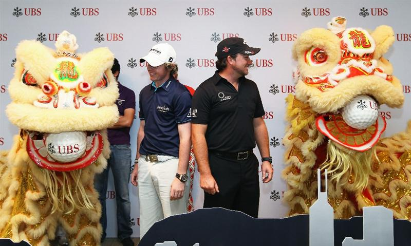 HONG KONG - NOVEMBER 16:  Graeme McDowell and Rory McIlroy of Northern Ireland during the UBS Hong Kong Open Opening Ceremony at the International Finance Centre on November 16, 2010 in Hong Kong, Hong Kong.  (Photo by Ian Walton/Getty Images)
