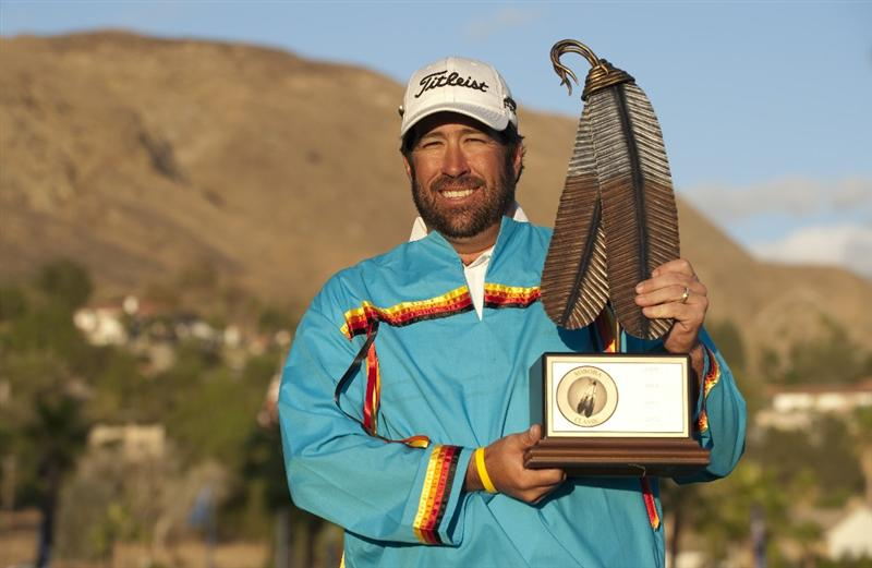 SAN JACINTO, CA - OCTOBER 04: Jerod Turner poses with the winner's trophy wearing a traditional Indian shirt after winning the 2009 Soboba Classic at The Country Club at Soboba Springs on October 4, 2009 in San Jacinto, California. (Photo by Robert Laberge/Getty Images)