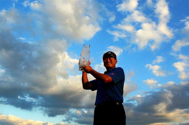 PONTE VEDRA BEACH, FL - MAY 15:  K.J. Choi of South Korea celebrates with the trophy after defeating David Toms on the first playoff hole during the final round of THE PLAYERS Championship held at THE PLAYERS Stadium course at TPC Sawgrass on May 15, 2011 in Ponte Vedra Beach, Florida.  (Photo by Streeter Lecka/Getty Images)