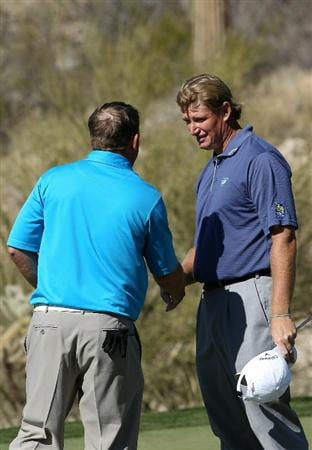 MARANA, AZ - FEBRUARY 24:  Ernie Els of South Africa (R) congratulates J.B. Holmes for winning on the 18th hole during the second round of the Accenture Match Play Championship at the Ritz-Carlton Golf Club on February 24, 2011 in Marana, Arizona.  (Photo by Sam Greenwood/Getty Images)