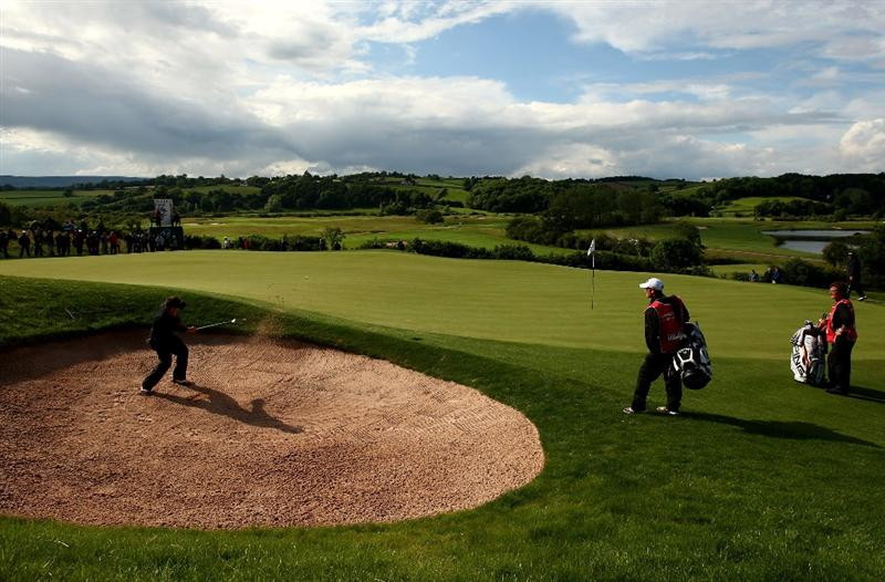 NEWPORT, WALES - JUNE 07:  Nick Dougherty of England plays from a greenside bunker on the 17th during the final round of the Celtic Manor Wales Open on the 2010 Course at The Celtic Manor Resort on June 7, 2009 in Newport, Wales.  (Photo by Richard Heathcote/Getty Images)