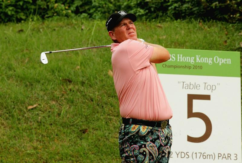 HONG KONG - NOVEMBER 18: John Daly of the USA plays a tee shot on the 5th hole during the first round of the USB Hong Kong Open at The Hong Kong Golf Club  on November 18, 2010 in Hong Kong, Hong Kong.  (Photo by Stanley Chou/Getty Images)