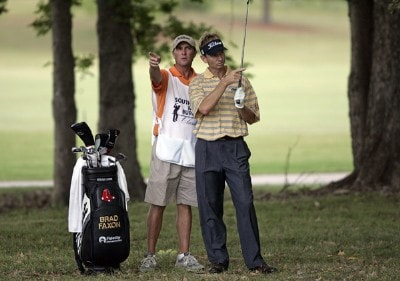 Brad Faxon confers with his caddie on the 13th hole during the third round of the Southern Farm Bureau Classic at Annandale Golf Club in Madison, Mississippi, on September 30, 2006. Photo by Hunter Martin/WireImage.com