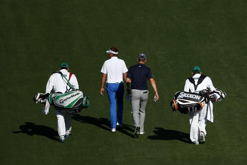 AUGUSTA, GA - APRIL 04:  Ian Poulter and Justin Rose of England walk with their caddies up a fairway during a practice round prior to the 2011 Masters Tournament at Augusta National Golf Club on April 4, 2011 in Augusta, Georgia.  (Photo by Andrew Redington/Getty Images)