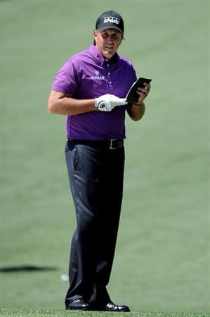 AUGUSTA, GA - APRIL 07:  Phil Mickelson looks over his yardage book on the second hole during the first round of the 2011 Masters Tournament at Augusta National Golf Club on April 7, 2011 in Augusta, Georgia.  (Photo by Harry How/Getty Images)