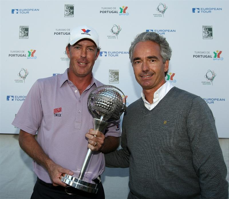 VILAMOURA, PORTUGAL - OCTOBER 17:  Richard Green of Australia receives the trophy from Bernardo Trindade, Secretary of State for Tourisim after the final round of the Portugal Masters at the Oceanico Victoria Golf Course on October 17, 2010 in Vilamoura, Portugal.  (Photo by Richard Heathcote/Getty Images)