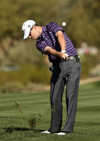 SCOTTSDALE, AZ - JANUARY 31:  Zach Johnson hits his second shot on the second hole during the third round of the FBR Open on January 31, 2009 at TPC Scottsdale in Scottsdale, Arizona.  (Photo by Stephen Dunn/Getty Images)