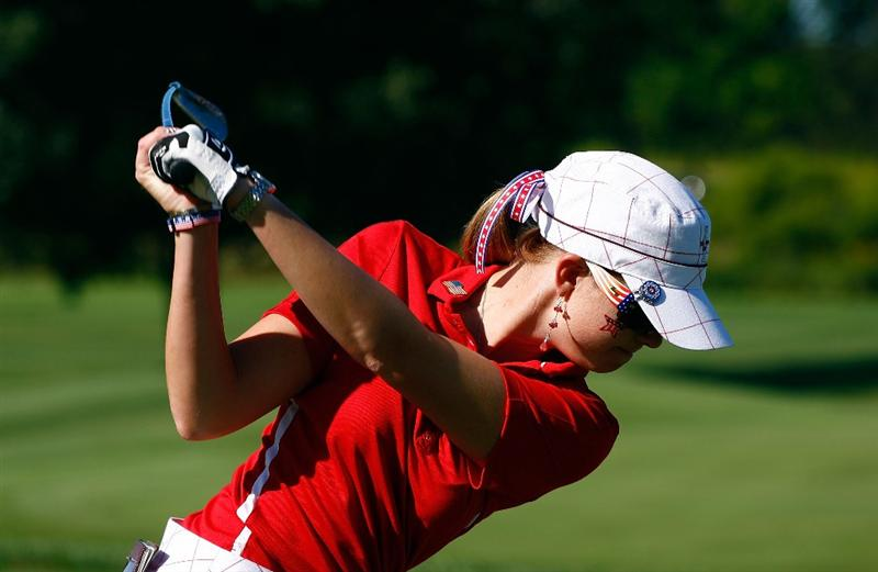 SUGAR GROVE, IL - AUGUST 23:  Paula Creamer of the U.S. Team hits a shot on the practice ground during the Sunday singles matches at the 2009 Solheim Cup at Rich Harvest Farms on August 23, 2009 in Sugar Grove, Illinois.  (Photo by Scott Halleran/Getty Images)