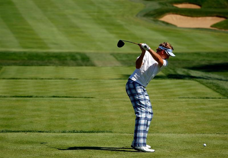 LEMONT, IL - SEPTEMBER 13:  Ian Poulter of England hits his tee shot on the fifth hole during the final round of the BMW Championship held at Cog Hill Golf & CC on September 13, 2009 in Lemont, Illinois.  (Photo by Scott Halleran/Getty Images)