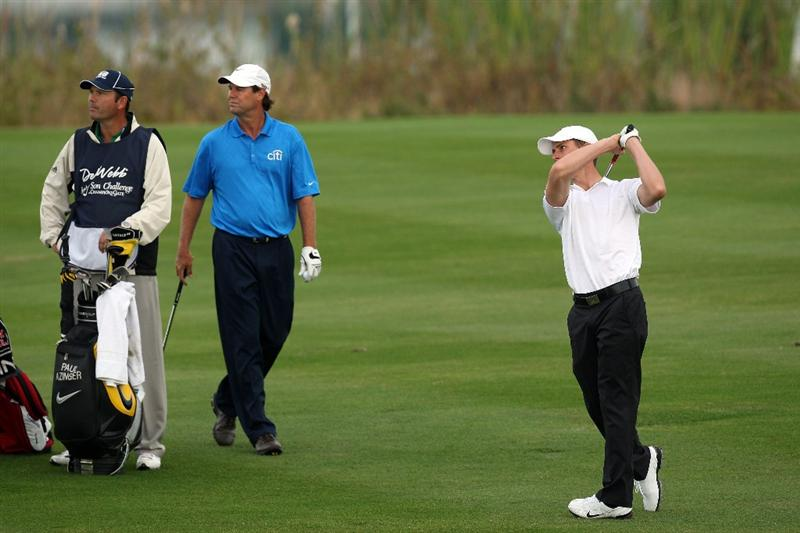 CHAMPIONS GATE, FL - DECEMBER 06:  Paul Azinger of the USA watches his partner Aaron Stewart the son of the late Payne Stewart on the 1st fairway during the first round of the Del Webb Father Son Challenge on the International Course at Champions Gate Golf Club on December 6, 2008 in Champions Gate, Florida.  (Photo by David Cannon/Getty Images)