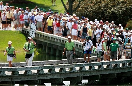 REUNION, FL - APRIL 14:  The gallery follows the final group of Laura Davies, Lorena Ochoa and Natalie Gulbis to the seventh hole during the third round of the Ginn Open at the Ginn Reunion Resort on April 14, 2007 in Reunion, Florida.  (Photo by Doug Benc/Getty Images)