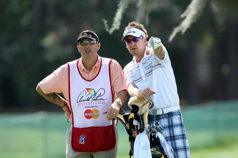 ORLANDO, FL - MARCH 26:  Ian Poulter of England prepares to hit his tee shot at the 5th hole with th ehelp of his caddy Terry Mundy of England during the first round of the Arnold Palmer Invitational Presented by Mastercard at the Bay Hill Club and Lodge on March 26, 2009 in Orlando, Florida  (Photo by David Cannon/Getty Images)