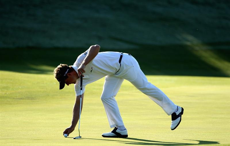 CASARES, SPAIN - MAY 22:  Luke Donald of England marks his ball on the second green during the semi final of the Volvo World Match Play Championship at Finca Cortesin on May 22, 2011 in Casares, Spain.  (Photo by Warren Little/Getty Images)