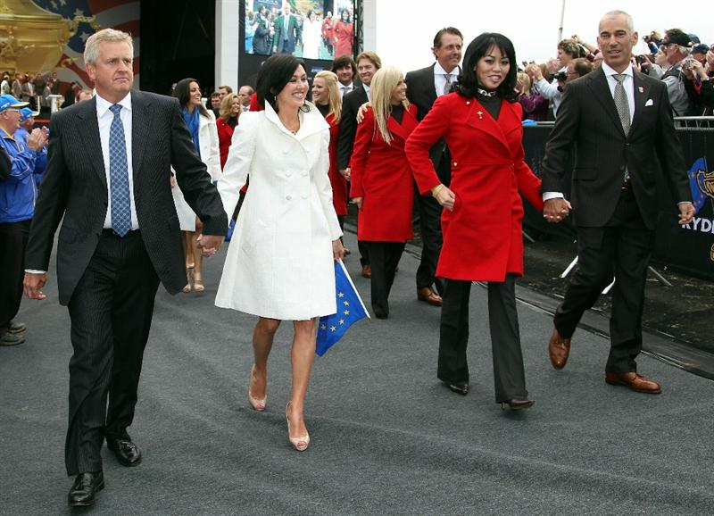 NEWPORT, WALES - SEPTEMBER 30:  Team Captain of the USA Corey Pavin (R) and Wife Lisa and Colin Montgomerie of Europe and Wife Gaynor lead out the players and their wives and girlfriends during the Opening Ceremony prior to the 2010 Ryder Cup at the Celtic Manor Resort on September 30, 2010 in Newport, Wales.  (Photo by Ross Kinnaird/Getty Images)
