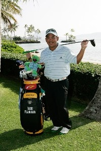 Tadd Fujikawa poses with his bag during practice at the Sony Open in Hawaii held at Waialae Country Club on January 9, 2008 in Honolulu, Hawaii. PGA TOUR - 2008 Sony Open in Hawaii - Pro-AmPhoto by Stan Badz/PGA TOUR/WireImage.com