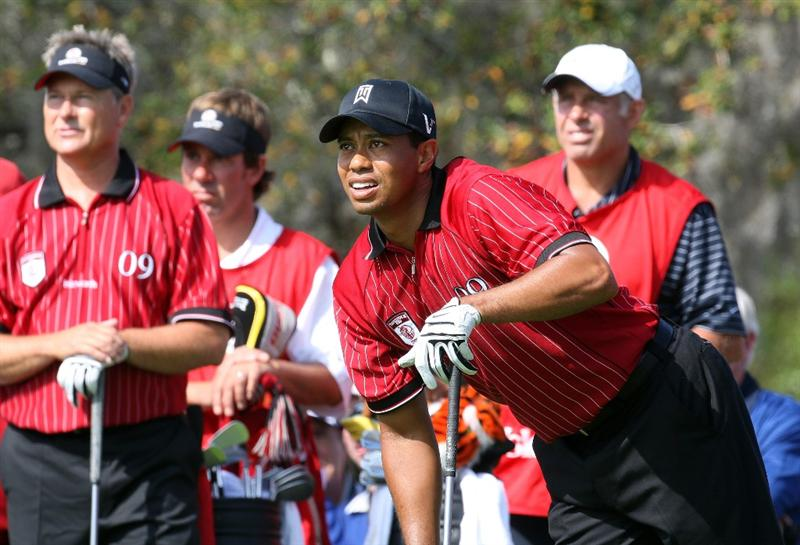 ORLANDO, FL - MARCH 16:  Tiger Woods of the USA and the Isleworth Team wathced by his partner John Cook at the 1st hole during the first day of the 2009 Tavistock Cup at the Lake Nona Golf and Country Club, on March 16, 2009 in Orlando, Florida  (Photo by David Cannon/Getty Images)