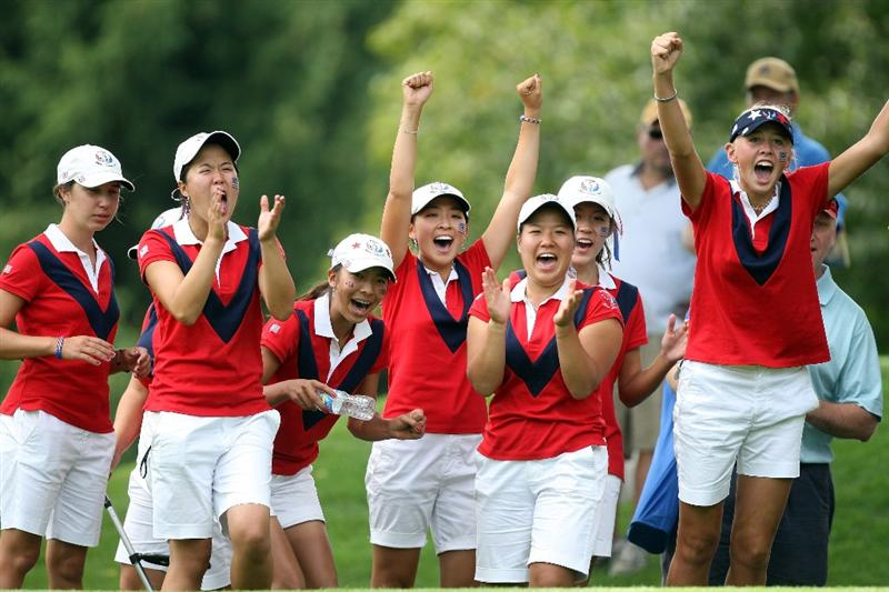 AURORA, IL - AUGUST 19:  Members of the victorious USA team celebrate while watching the endo f the late matches on the final day of the 2009 Junior Solheim Cup Matches, at the Aurora Country Club on August 19, 2009 in Aurora, Ilinois  (Photo by David Cannon/Getty Images)