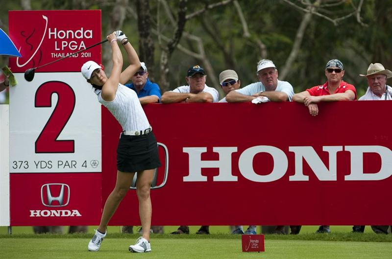 CHON BURI, THAILAND - FEBRUARY 17:  Michelle Wie of USA tees off on the 2nd hole during day one of the LPGA Thailand at Siam Country Club on February 17, 2011 in Chon Buri, Thailand.  (Photo by Victor Fraile/Getty Images)