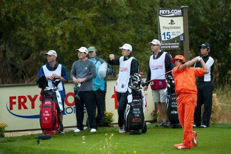 SAN MARTIN, CA - OCTOBER 17:  Rickie Fowler makes a tee shot on the 15th hole as Tim Clark and Ryuji Imada of Japan and their caddies look on during the final round of the Frys.com Open at the CordeValle Golf Club on October 17, 2010 in San Martin, California.  (Photo by Robert Laberge/Getty Images)