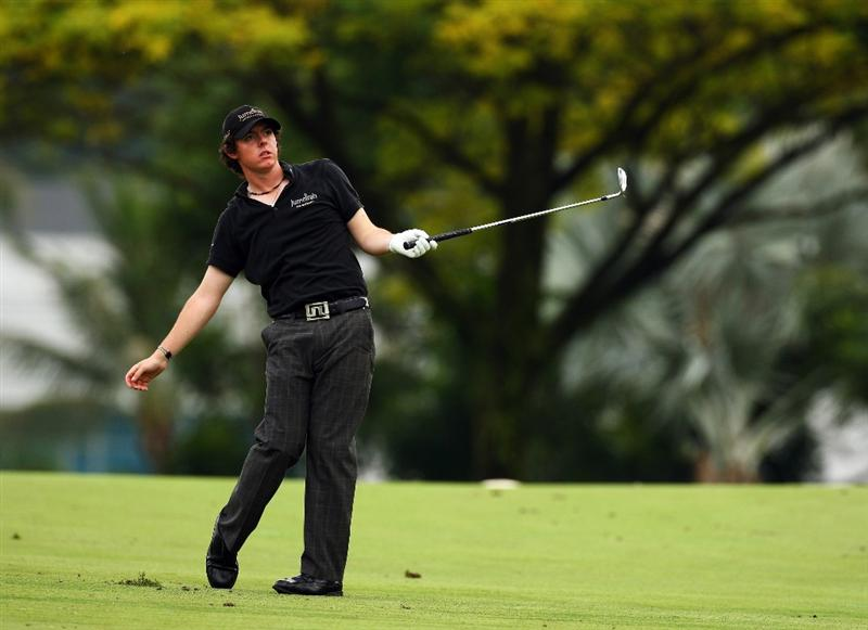 SINGAPORE - NOVEMBER 14:  Rory McIlroy of Northern Ireland reacts to a shot during the second round of the Barclays Singapore Open at Sentosa Golf Club on November 14, 2008 in Singapore.  (Photo by Ian Walton/Getty Images)