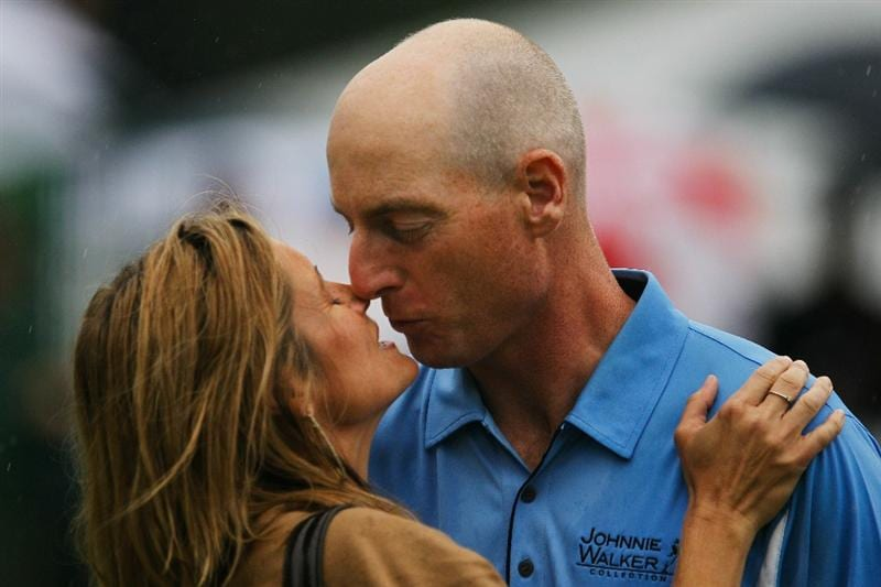 ATLANTA - SEPTEMBER 26:  Jim Furyk (R) kisses his wife Tabitha (L) in celebration of winning the FedExCup and THE TOUR Championship presented by Coca-Cola, the final event of the PGA TOUR Playoffs for the FedExCup, at East Lake Golf Club on September 26, 2010 in Atlanta, Georgia.  (Photo by Scott Halleran/Getty Images)
