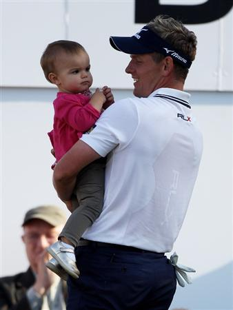 VIRGINIA WATER, ENGLAND - MAY 29:  Luke Donald of England holds his daughter Elle following his victory in a playoff on the 18th green during the final round of the BMW PGA Championship  at the Wentworth Club on May 29, 2011 in Virginia Water, England.  (Photo by Warren Little/Getty Images)