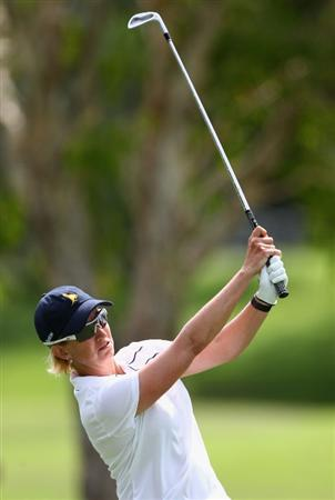 GOLD COAST, AUSTRALIA - MARCH 07:  Karrie Webb of Australia plays an approach shot on the 13th hole during round four of the 2010 ANZ Ladies Masters at Royal Pines Resort on March 7, 2010 in Gold Coast, Australia.  (Photo by Ryan Pierse/Getty Images)