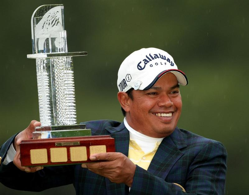 MIYAZAKI, JAPAN - NOVEMBER 23:  Prayad Marksaeng of Thailand poses with the trophy after winning the Dunlop Phoenix Tournament 2008 at Phoenix Country Club on November 23, 2008 in Miyazaki, Japan.  (Photo by Koichi Kamoshida/Getty Images)